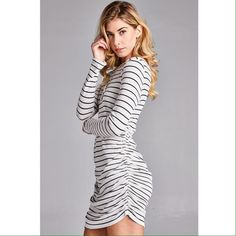 Thermal dress with black stripes. Flattering ruching on sides. Dresses