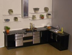 https://flic.kr/p/5Atb4i | Another version of a 1/12th scale black and steel kitchen | From my Mornington range, these units have fixed doors, but with clear worktops and open glass shelving there is ample space for displaying miniatures.  Black hi-gloss units with co-ordinating steel drawers and oven front.   These units are available for sale on my website, www.store2go.net/shop/elfminiatures