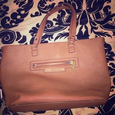Brown juicy couture tote purse High quality purse. Good condition, the inside needs to be wiped out. Juicy Couture Bags Totes