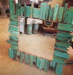 Use salvaged wood to make a mirror frame.