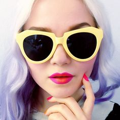 Pink/orange two-tone ombre lip is easy with Centrifuchsia and My Beautiful Rocket. Paint your lips with Centrifuchsia, leaving the middle empty. Fill in with My Beautiful Rocket and roll your lips together. Voila! Get your color fix on www.limecrimemakeup.com. Sunglasses courtesy of Nasty Gal.
