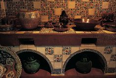 """Mexican kitchen.  The """"pretil"""" or counter is tiled as is the wall.  Tiled arches underneath.  Melba Levick photo, Mexicocina."""