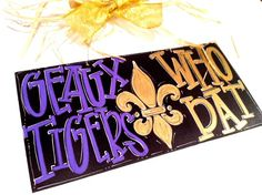 Geaux Tigers / Who Dat - 6x12 Hand Painted Wood Sign with Fleur de Lis - LSU and New Orleans Saints Team Sign. . $33.00, via Etsy.