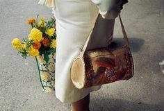 Raffia bag and printed shopping bag, 1975  Vivian Maier Photographer