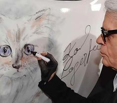 """Choupette is a luxurious long-haired kitty who claims the fashion designer Karl Lagerfeld as her human. Her trending Instagram account gets right to the heart of her appeal, calling her a """"spoiled Chanel pussy whose maids pamper her every need."""" She has also inspired the iconic designer's Choupette In Love line of clothing and accessories. …"""