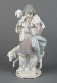 "Lot 14, A Lladro figure Shepherd Boy 5405 8 1/2"" boxed, Est £40-80"