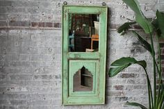 Moroccan mirror on your wall...this will definitely be the fairest of them  all! A perfect global accent to work into any style of decor, this  distressed antique frame Indian mirror will add the perfect touch of rustic  elegance. Simply beautiful!  We have many more of these mirrors in differe