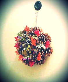 DIY cone wreath with wooden squirrels, textile leaves and dried flowers - door decoration