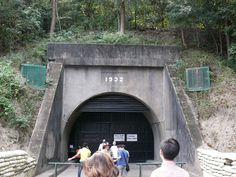 Corregidor- Entrance to the Malinta Tunnel. Built from 1922-1932 to serve as a bomb shelter.  The inside of the tunnel is 24' wide and 18' high, with 13 lateral tunnels branching out from the main one. A trolley line runs through the middle of the tunnel and blowers supplied the tunnel with fresh air.  The tunnel served as a hospital, communications center, and General MacArthur's headquarters during the siege of Corregidor.