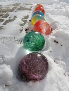 During winter fill balloons with water and add food coloring. Once frozen, cut the balloons off & they look like giant marbles or Christmas decorations. More fun with ice via click-through!