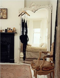 the mirror. West London home of the design team Preen photographed by dylan thomas (for British Vogue). story here: http://hellolovelyinc.blogspot.com/2010/11/dylan-thomas-thornton-and-bregazzi-home.html