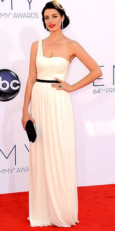 Emmys 2012: JESSICA PARÉ  Mad Men's breakout star takes her first big awards show in stride, wearing a beautifully fitted white one-shoulder gown by Jason Wu with black accents, Bulgari jewels and dramatic red lips.