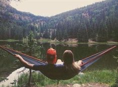 Laying on a hammock with him by a lake in the woods