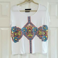 MinkPink (Nordstrom) Short sleeve Tshirt .fabric is 80% rayon 20% polyester. Top has been gently washed snd worn. No rips or stains.   Label shows extra small top will fit small to medium also. MINKPINK Tops Tees - Short Sleeve
