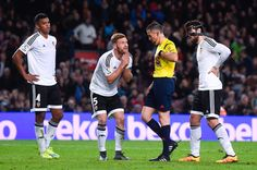 Shkodran Mustafi (C) of Valencia CF is shown a red card by the referee Ignacio Iglesias Villanueva for a challenge on Lionel Messi of FC Barcelona during the Copa del Rey Semi Final first leg match between FC Barcelona and Valencia at Nou Camp on February 3, 2016 in Barcelona