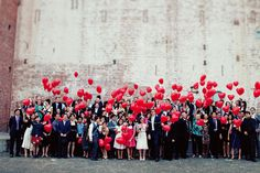 Red heart balloons released at the end of a wedding reception.  Bad for the environment, but great for a picture!