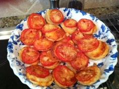 Paula Deen's Cheesy Tomato Tartlets using puff pastry.  So easy & delicious!