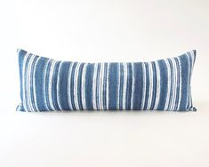 A decorative blue and white extra long lumbar pillow for a Full, or Queen bed. Insert: Included (Alternative Down) This fabric is printed Dimensions: 14x36 inches Cover is removable Fabric: 100% Cotton (Fabric same on back) Washing Instructions:Machine wash gentle cold, tumble dry low, cool iron. Also comes in 14x50 s