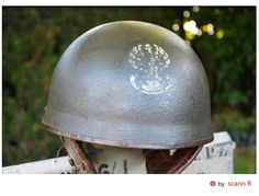 """RAC MK I tank driver's helmet: Authentic tank helmet unearthed in the Trun area. This helmet has a special feature ... the traditional inner helmet has been replaced by an American compressed-fiber helmet """"Tanker Helmet M-1938"""" manufactured by Rawlings. A rare piece in an excellent state of preservation! 