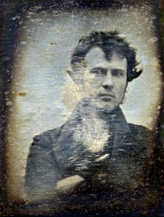1839 image of Philadelphia chemist and silversmith Robert Cornelius. This is the first known photographic image of a human being. This photograph on silver plate is said to be taken outside of his place of business (on 8th Street) in Philadelphia.