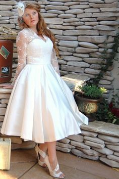sleeves on a wedding dress - always repin worthy in my book. I love em This is a really pretty dress for the reception so it gives room to dance easily :)