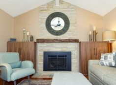 Family room and fireplace remodel using slate stacked stone, custom walnut cabinets, an antique oak mantle, and soft, comfortable furniture in huge same cool, calm blues and greens as the adjacent kitchen.