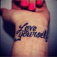 """Love Yourself tattoo but with """"Love"""" on the left hand and """"Yourself"""" on the right."""