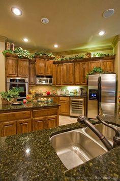 Traditional Medium Wood (Brown) Kitchen Cabinets (Kitchen-Design-Id. Decorating Above Kitchen Cabinets, Kitchen Decor Themes, Above Cupboard Decor, Top Of Cabinet Decor, Kitchen Ideas, Kitchen Cabinet Remodel, Kitchen Cabinet Design, Brown Decor, Brown Kitchens
