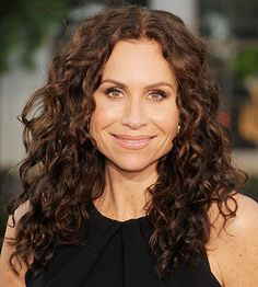 """Minnie Driver's curls never fall flat or look stringy -- and for that, she can credit her long, layered cut. """"There are just the right amount of medium-to-long layers to enhance the vitality and bounce in her curls,"""" Balding says."""
