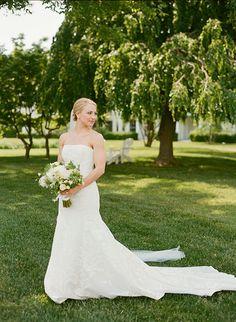 Chic Coastal Wedding in Maryland, Strapless Lace Carolina Herrera Wedding Dress | Brides.com