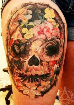 Flower skull tattoo illusion