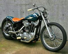 Ironhead Sportster hardtail custom with mini drum front brake, white pegs & grips, short exhaust