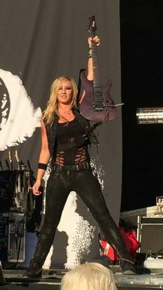 Nita Strauss with her Herman Li 'S' model Ibanez on stage with Alice Cooper