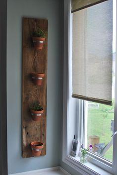 Kitchen window herb garden, with old barn board.