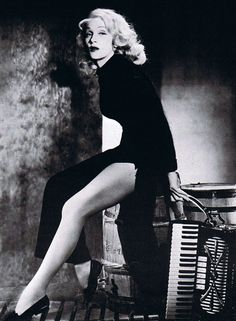 Marlene Dietrich, age 55, shows off the legs that made her famous, 1957.