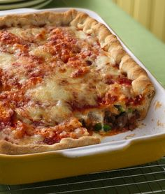 "The ""toppings"" for this pizza are stuffed inside two layers of delicious homemade crust. ""This recipe was awesome! My husband and I both LOVED it! It was really easy to make and pretty quick too!"" says Betty member MrsNewman. Pizza Recipes, Casserole Recipes, Beef Recipes, Cooking Recipes, Family Recipes, Pizza Casserole, Jamaican Recipes, Quiche Recipes, Casserole Dishes"