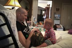 Joey and Rory. Little Indy seen her with mer mama who is battling stage 4 cervical cancer. Joey and Rory are amazing, as is their music. Amazing family and love.  This photo breaks my heart.