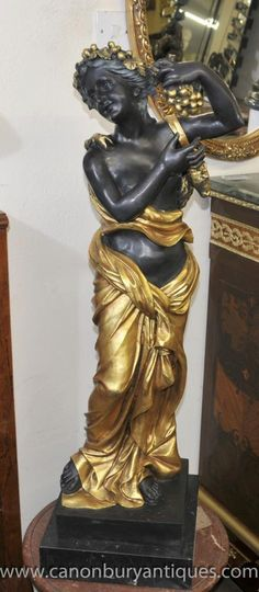 - Stunning Italian bronze semi clad maiden carrying grapes<br /> - Love the folds to the gilt coloured toga <br /> - Signed Perdier on the base <br /> - At just under four feet tall good size to this work of classical beauty<br /> - Museum quality to this piece, I could see this in the Getty Villa<br /> - Offered in great shape ready for home use right away<br /> - We ship to every corner of the planet - please get in touch for a shipping quote<br /> Dimensions are in CM<br /> Height x… Getty Villa, Architectural Antiques, Corner, Museum, Bronze, Base, Quote, Ship, Touch