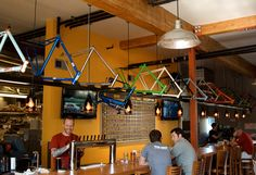 A cyclists and other patrons of the bar.