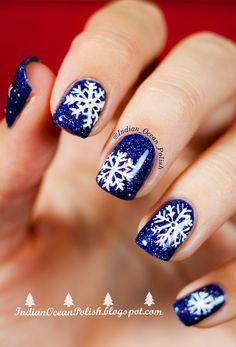 Blue glitter and white snowflake nails