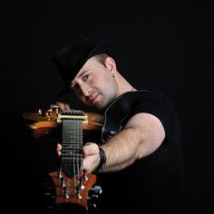 Guitarist I by R .G.