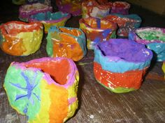 Students used clay for the first time to create small clay pinch pots. They started with a ball of clay and made a hole using their thumb. Then they pinched around the outside edge to shape their pot. After they were dried (use self drying clay) students painted them with tempera cakes.