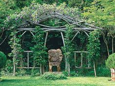 An allée of arches constructed from juniper branches and a single rod of rebar create a pleasing repetition in this Georgia garden belonging to designer Ryan Gainey. (Photo: Roger Foley)