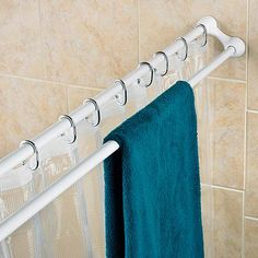 This is brilliant and perfect for our current master bath: Shower Curtain Rod & Towel Bar. Space saver! This shower curtain rod and towel bar is a great way to create an extra storage area in your bathroom. Outer bar provides room for towels and other items.