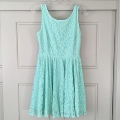 "Forever 21 Lace Dress Mint green (color is closest to the picture with the tag), lace dress with see through lace ""V"" back. It has a side zipper and has never been worn. Forever 21 Dresses Mini"