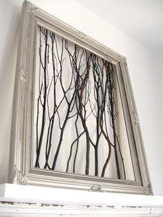 I love DIY-ing home decor. This is such an easy to recreate decorative piece using only twigs or branches and a picture frame. (You could always paint the branches or frame for some added drama.) #DIYHomeDecorPictures