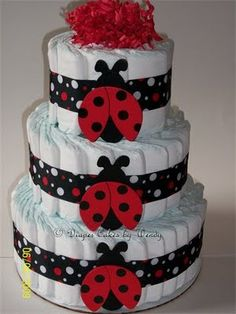 Diaper Cakes have two purposes: to look adorable and for baby diapers.  A diaper cake with a ladybug theme goes great for your ladybug baby shower theme.