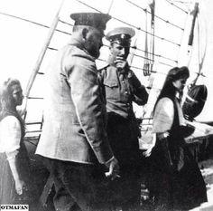 "The Grand Duchesses Maria and Tatiana Nikolaevna Romanova of Russia with Dr Evgeny Sergeyevich Botkin and a crew member. ""AL"""