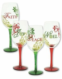 "Traditions of Christmas Glasses by Evergreen Enterprises, Inc. $59.99. Hand painted wine glass. 4 Assorted. Holds 12 oz.. Hand wash only. 3.5""W x 9""H. The magic of the season is on display on these hand-painted wine glasses as red, green, and gold designs surround each one. They declare, ""Faith,"" ""Joy,"" ""Peace,"" and ""Noel"" with the warm spirit of the holidays. Whether sipping wine or water from these glasses, one cannot help but smile at their colorful, lively spirit, perfect ..."