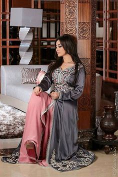 The slate grey coloured​ outfit with subtle touches of pink gives the entire outfit a ten on ten not to avoid the gorgeous designing on top or it. Absolutely fell in love with this number.